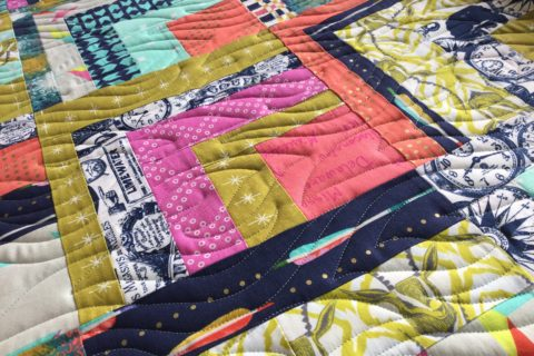 Modern quilt kindling on cotton and steel.